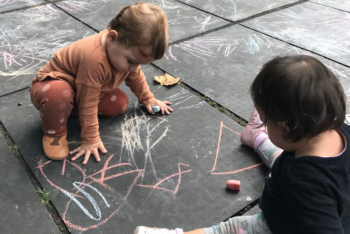 babies playing on the floor